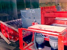 Push-table design discharges mold onto Gamma Low-Level reclamation unit